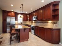 Amber Cherry Mitred Raised Kitchen Cabinets With A Brown ...