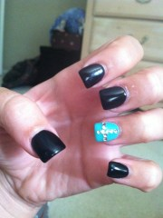 black and teal nails with cross