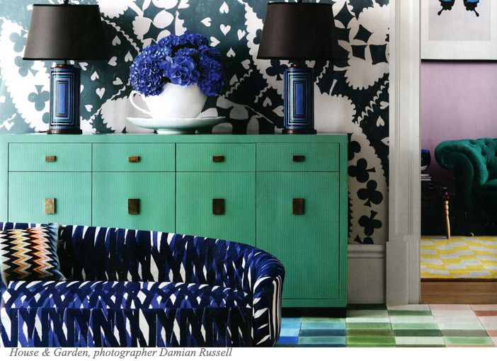 graphic dark wallpaper, graphic fabric, green sideboard, pink walls