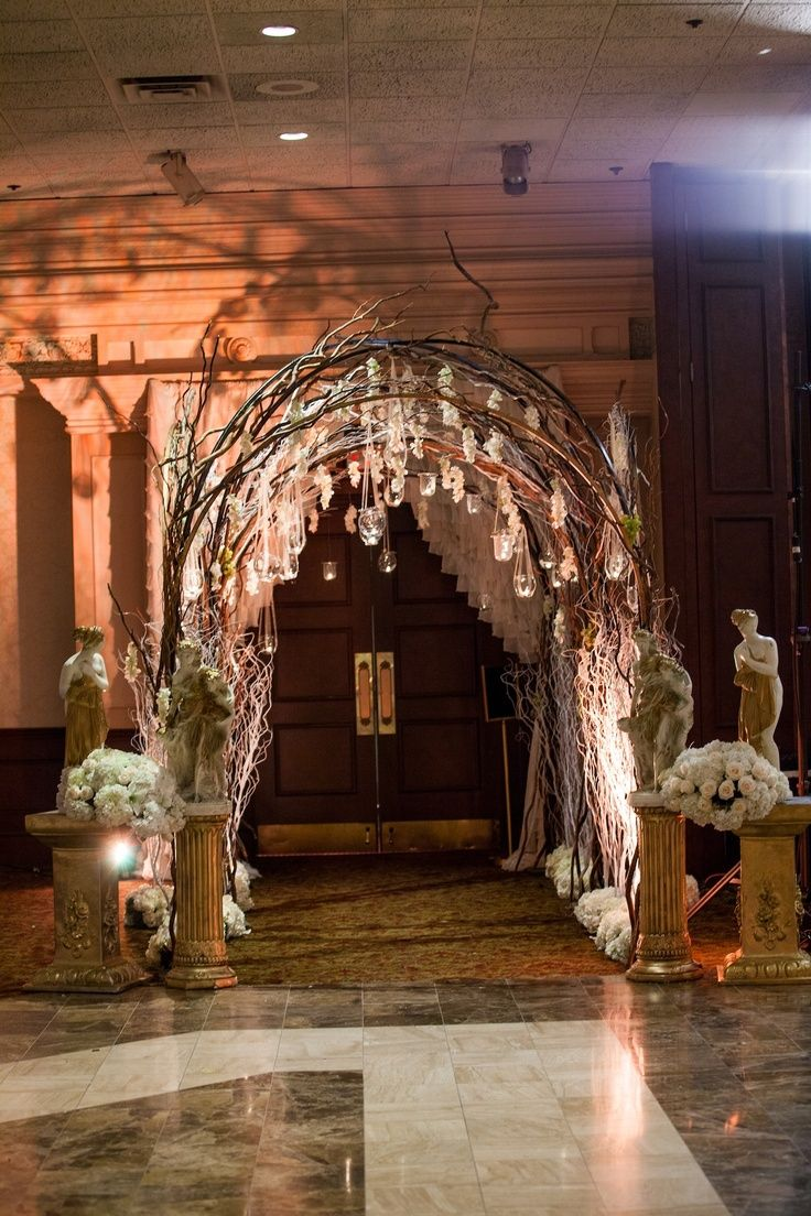 rustic proms  Entrance adorned with draping flowers and a