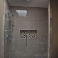Shower with large rectangular tiles and a very large niche ...