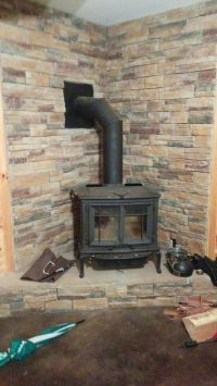 25+ best ideas about Corner Wood Stove on Pinterest