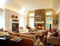 Love the stone rounded fireplace and windows on both side ...