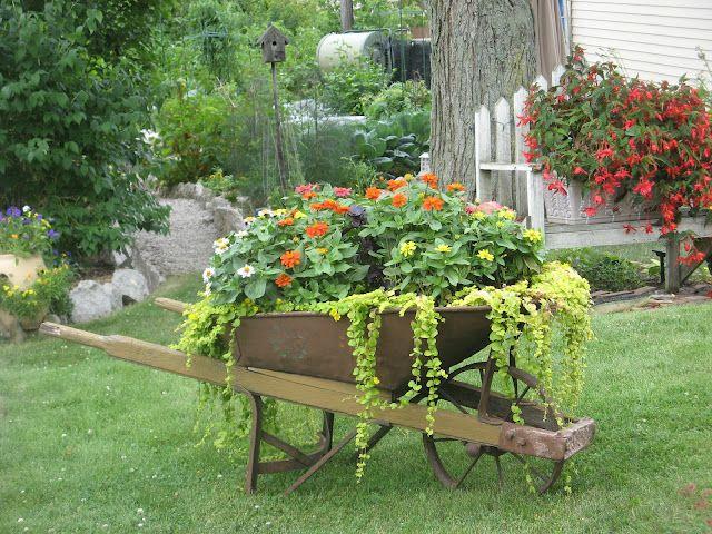 25 Best Ideas About Wheelbarrow Planter On Pinterest