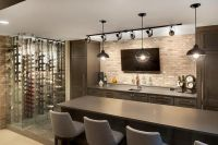 Contemporary basement bar features dark brown cabinets ...