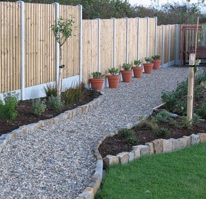 gravel walkway with planters