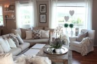 Beige living room. Love the gray and white pillow accents