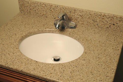 For main bath31 x 22 Riverstone Quartz Vanity Top at