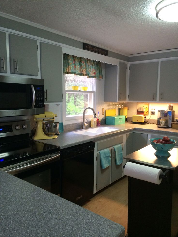 Painted my very plain kitchen cabinets Easy with Dixie