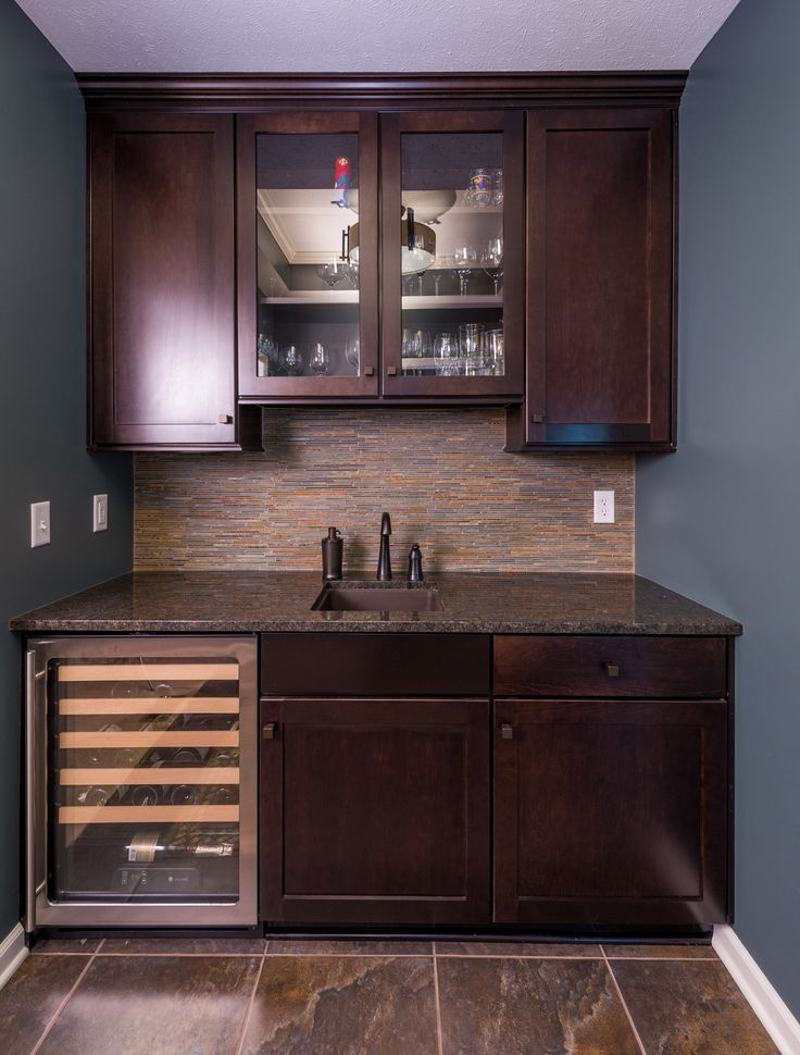 Simple wet bar design with dark wood shakerstyle