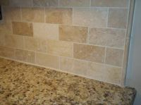 Venetian gold granite with a simple Travertine subway tile ...