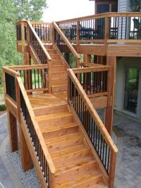 High deck with long staircase with landing. Nice railing ...