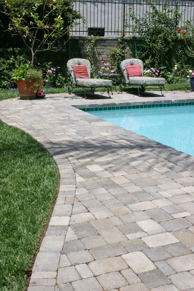 Pavers around a pool. More expensive than poured concrete
