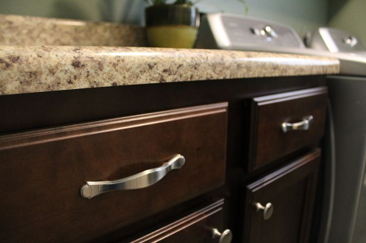 Handles on cabinet drawers and knobs on cabinet doors