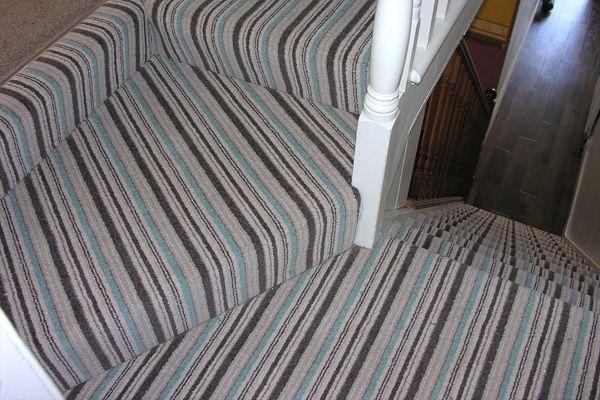 striped carpet on stairs plain on landing