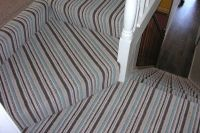 striped carpet on stairs plain on landing