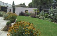 A wide shallow contemporary garden design in Windsor ...
