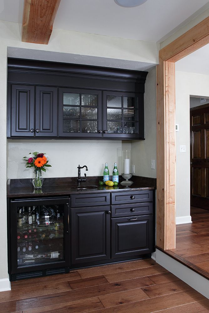 The wet bar includes custom cabinetry a Bronzo Quartzite