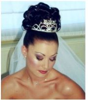 curly wedding hairstyle wtih tiara