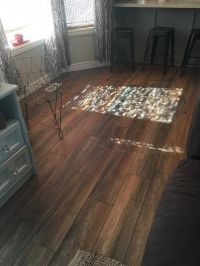 """Updating from porcelain tile and carpet to laminate ..."