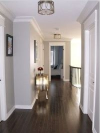 Dark floors, soft grey wall color, and white moulding ...
