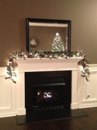 Black subway tile fireplace with white mantel and trim ...
