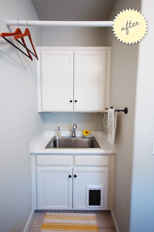 Cat door in a cabinet for litter box in laundry roomI