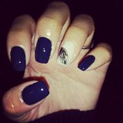 navy blue nails and black feather