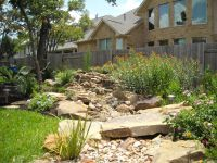Backyard landscape - disappearing stream with a huge ...