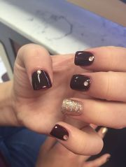 maroon and gold acrylics nails