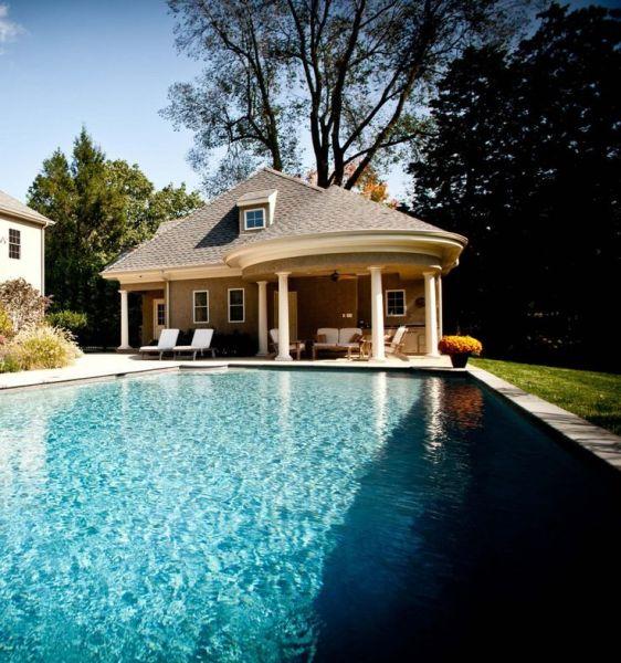 pool house with outdoor kitchen Pool house with circular portico and outdoor kitchen. #pool, #poolhouse, #backyard | Backyard