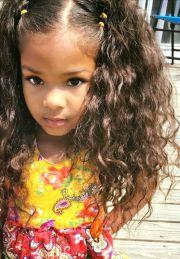 beautiful baby girl with long wavy