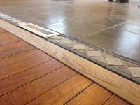 Threshold tile to wood floor in open concept living room ...