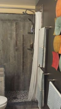 "Walk-in shower with pony wall and 84"" shower curtain. I ..."