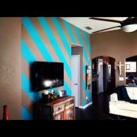 Painted diagonal stripes on my living room wall. They were