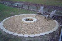 Fire pit - stone work around the edge and add sand instead ...