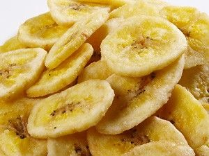 Slice banana into thin chips, dip in lemon juice, and spread on a cookie sheet. Bake for 2 hours @ 200 degrees and flip. Bake for