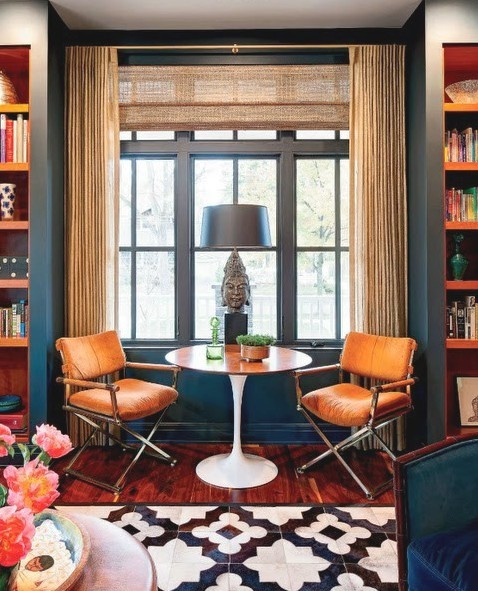 dark tealnavy and rustorange living area  book shelves