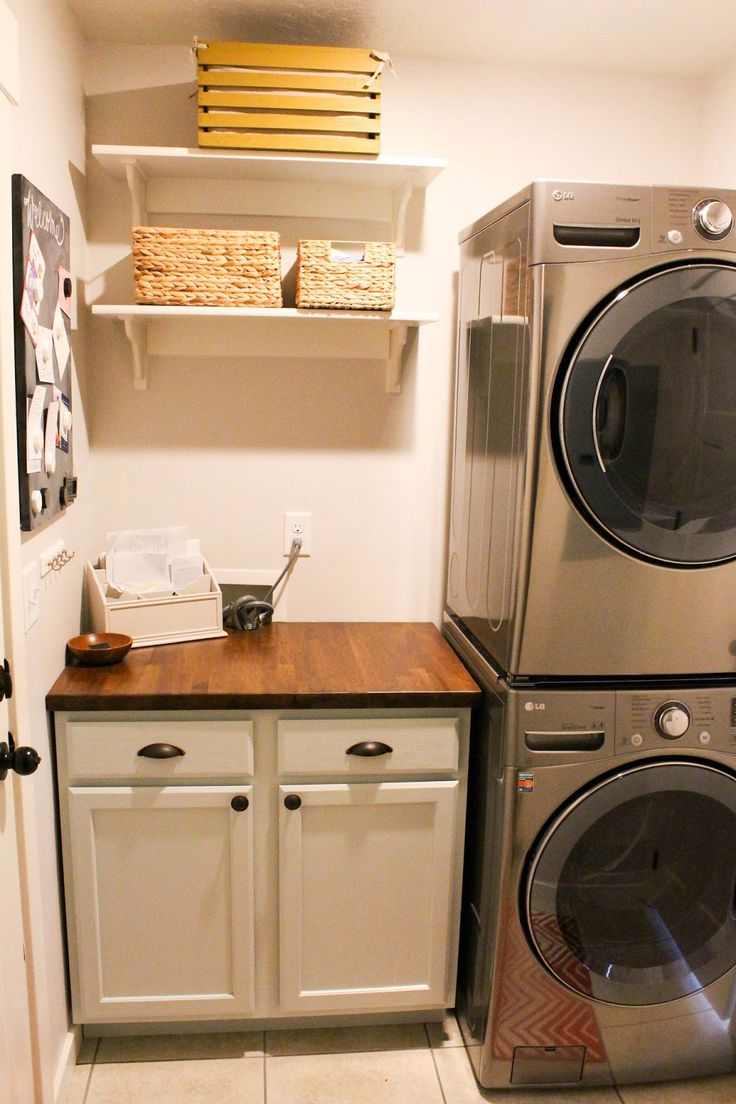 Small Laundry Room With Wood Grain Tile Floor Black Cabinets And