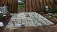 Concrete pavers were cheap and have texture on top. later ...