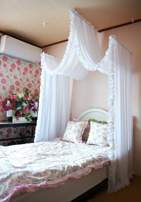 A romantic bed curtain  i like this over a little girls