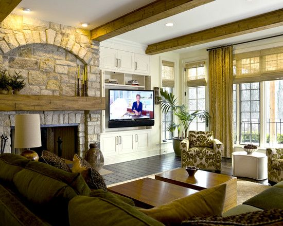 Put the tv next to the fireplace in a builtin cabinet TV