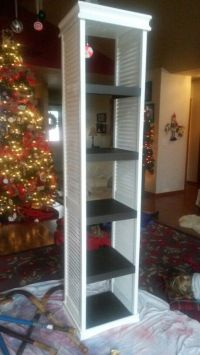 Repurposed bifold doors made into a shelving unit by my