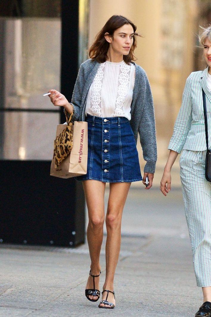 Alexa Chung in a button down denim A-line skirt, perfect for summer 2015.: