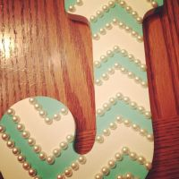 Wooden letter, painters tape, aqua paint, and pearls ...