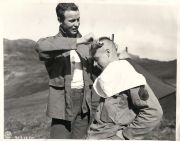 wwii u. soldier give comrade