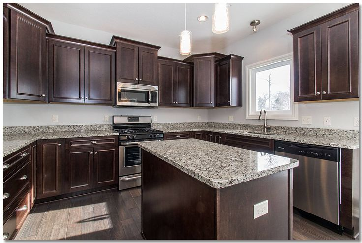 Traditional Kitchen With Espresso Cabinets And Granite