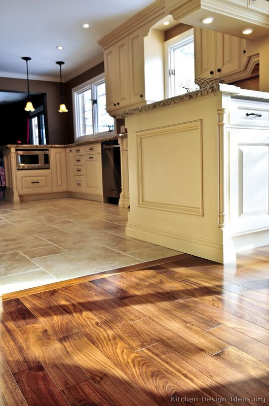 #Kitchen Idea of the Day: Perfectly smooth transition from hardwood flooring to tile floors in an open-plan kitchen.