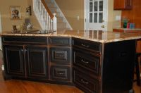 I love the look of distressed black kitchen cabinets ...