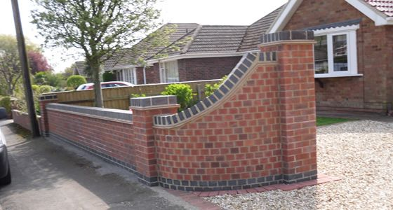 Front Wall Design Curved With Grey Coping Stones Garden Walls